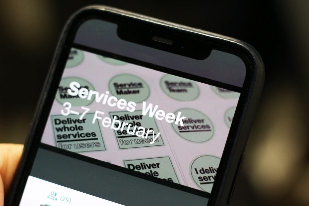 A closeup of a smartphone display showing Services Week, 3–7 February