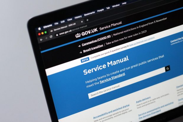 Close-up of a laptop screen showing the website of the GOV.UK Service Manual stating its purpose: Helping teams to create and run great public services that meet the Service Standard.