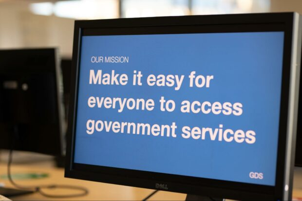 Computer monitor with presentation slide on the screen which reads 'Our mission. Make it easy for everyone to access government services'